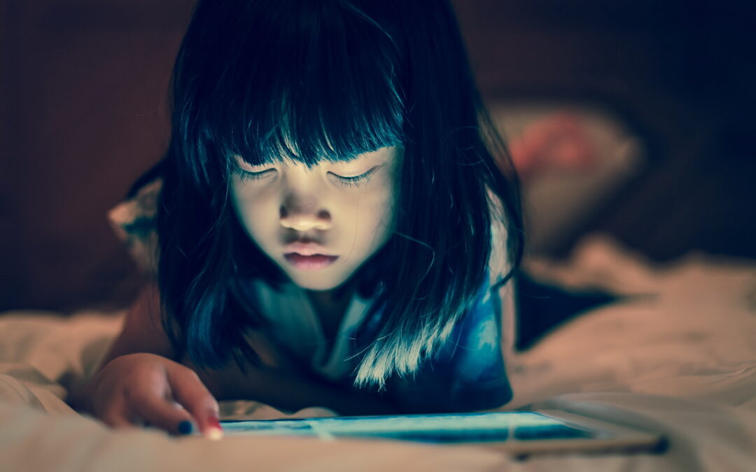 A girl reading about internet safety for kids on a tablet
