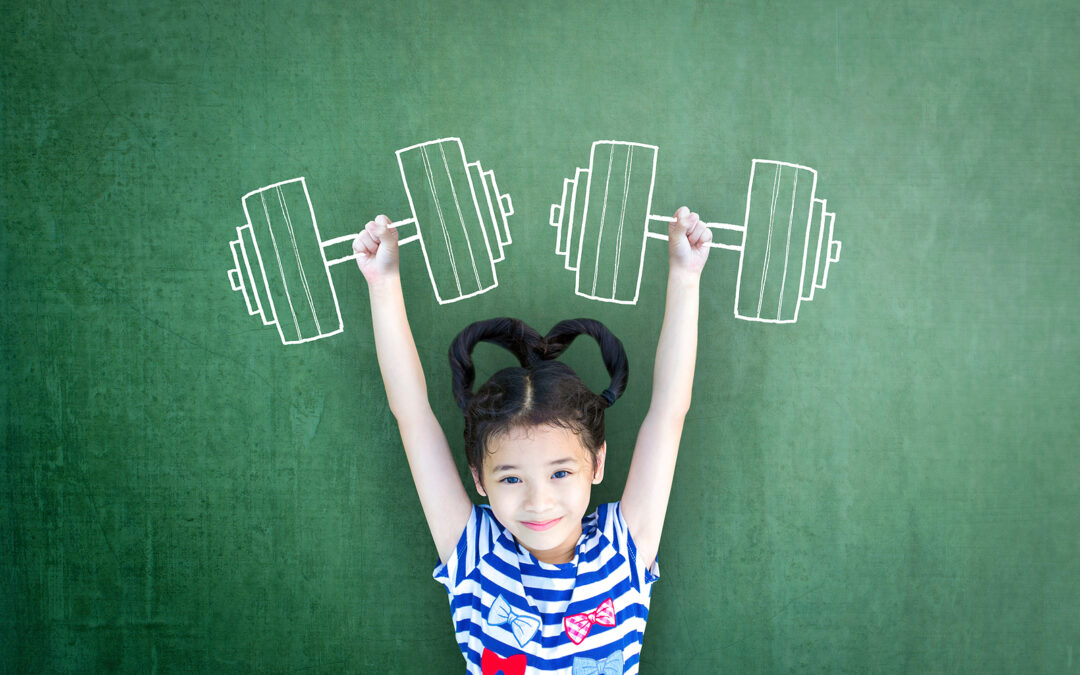 Young girls holding drawn on weights to signify how Kidspiration empowers dyslexic children.