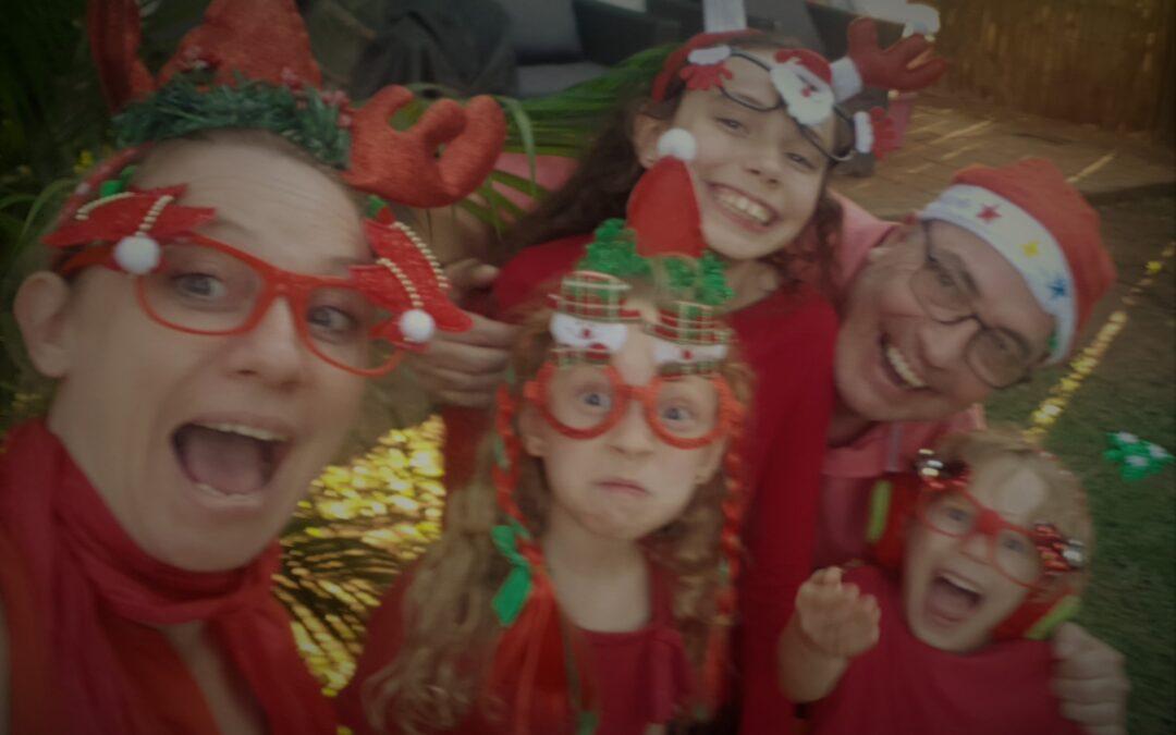 Family wishing everyone a Merry Christmas