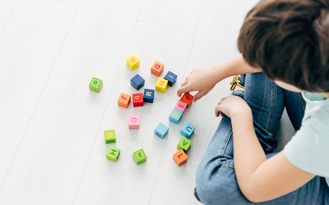 A child using coloured alphabet blocks to demonstrate what is the Orton-Gillingham approach to learning