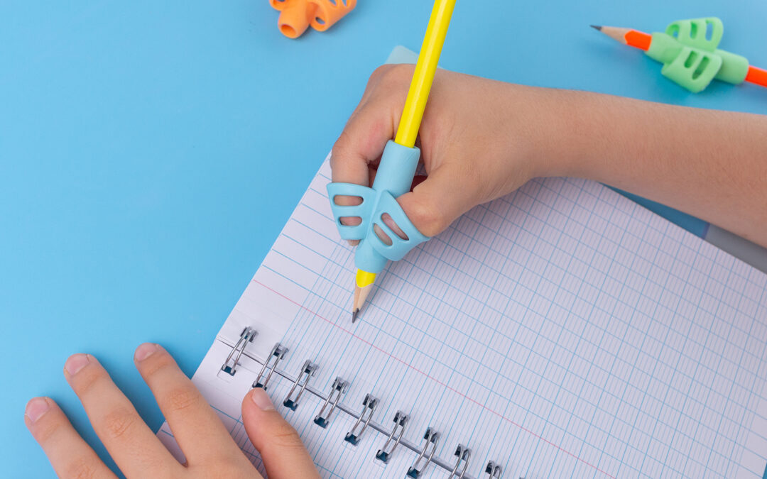 An ergonomic pencil grip is being used for fun activities for dysgraphia