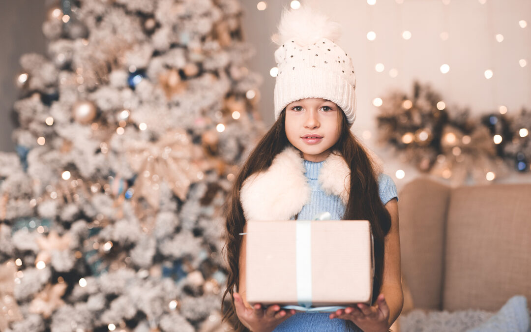 a young girl giving the best gifts for 5-7 year olds