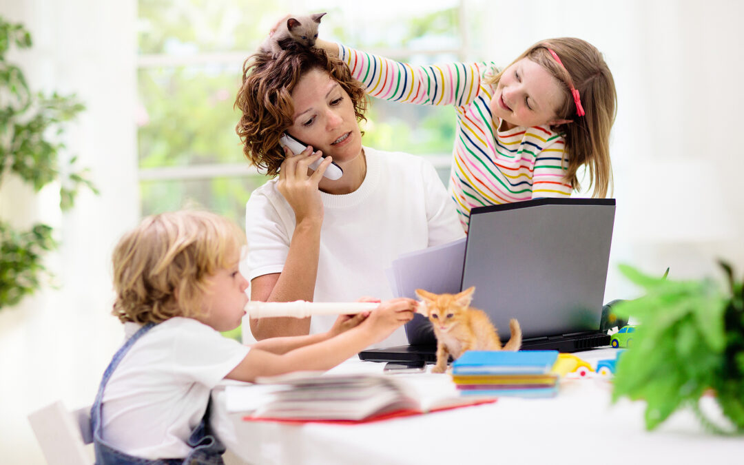A mum trying work with kids and kittens all over her, asking herself how do I teach my dyslexic child from home?