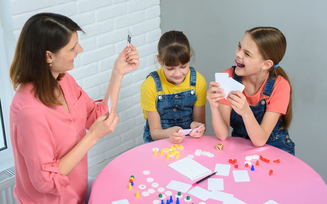 mom and daughters playing games for dysgraphia