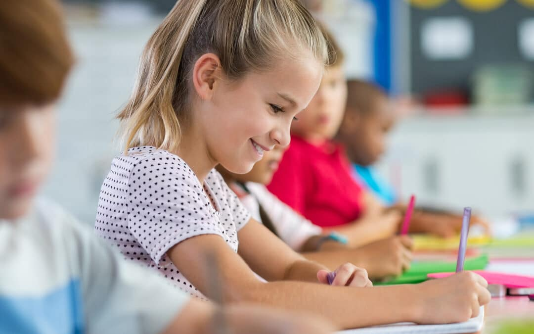 A girl smiling as she plays dysgraphia games