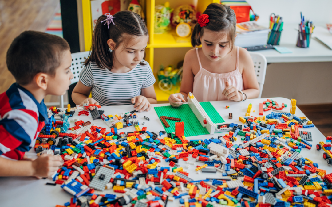 an image showing kids playing with Lego - and example of timeless toys